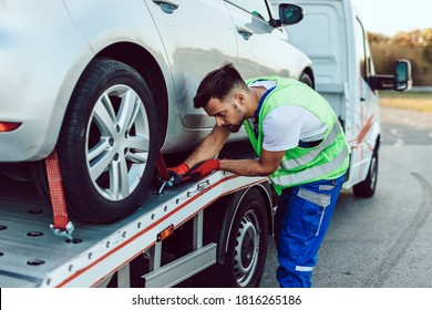 Handsome middle age man working in towing service on the road. Roadside assistance concept.