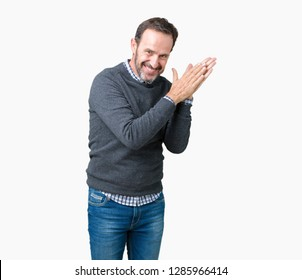 Handsome middle age senior man wearing a sweater over isolated background Clapping and applauding happy and joyful, smiling proud hands together