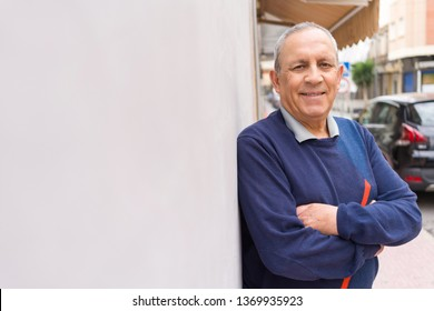 Handsome middle age senior man smiling cheerful, happy and positive leaning over white background with crossed arms