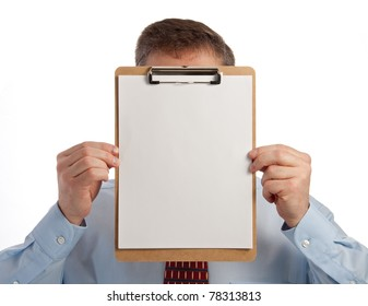 Handsome middle age successful businessman holding clip board in front of face - with clipping path for paper