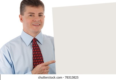 Handsome middle age successful businessman points to sign - with sign clipping path