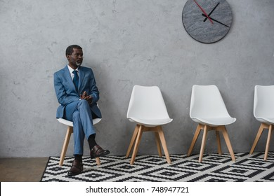 Handsome middle aged African american businessman sitting in a waiting room