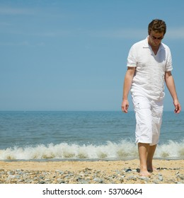 handsome middle aged man by seaside