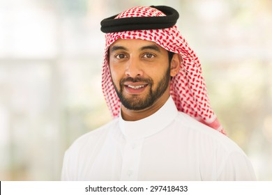 handsome middle eastern man looking at the camera