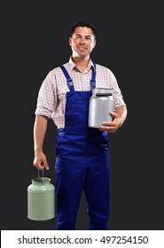 Handsome milkman on dark background