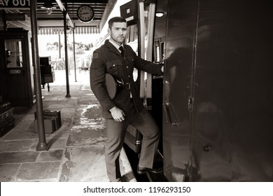 Handsome miltary world war 2 air force male officer in uniform boarding vintage steam train