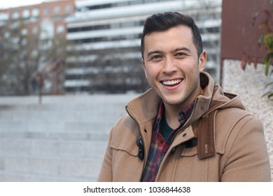 Handsome mixed race male smiling outdoors