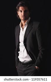 Handsome model in elegant dress . Low key light portrait