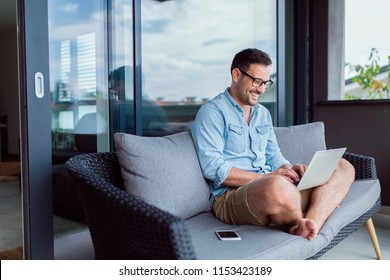 Handsome modern young man working remotely from home