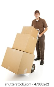 Handsome moving man or courier delivering a stack of boxes.  Isolated on white.
