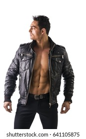 Handsome muscle man wearing leather jacket on naked torso, isolated on white background looking to a side