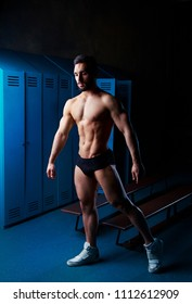 handsome muscular athletic man   in the locker room after working out