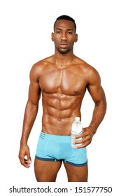 A handsome, muscular black make athlete, holding a bottle of water, isolated on a white background with generous copyspace.
