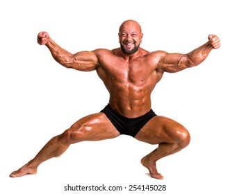 Handsome muscular bodybuilder posing on a white background