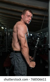 Handsome Muscular Fitness Bodybuilder Doing Heavy Weight Exercise For Triceps In The Gym