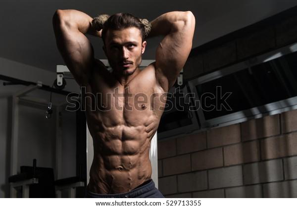 Handsome Muscular Fitness Bodybuilder Doing Heavy Stock