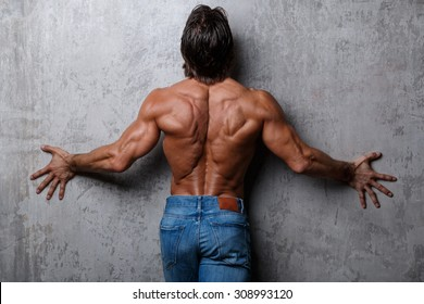 Handsome muscular guy in jeans