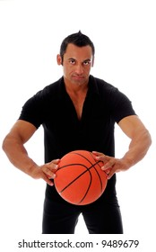 Handsome muscular hispanic male with basketball