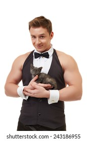 Handsome muscular male dancer posing with kitten