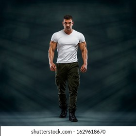Handsome Muscular Male Fashion Model Wearing Army Pants and Boots