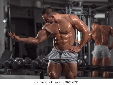 Handsome muscular man in gym.