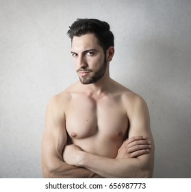 Handsome muscular man posing with naked chest
