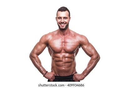 Handsome muscular man posing in studio.