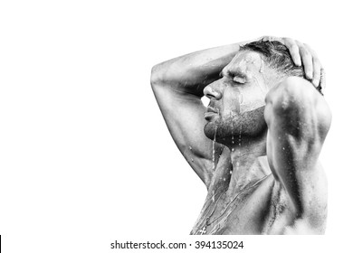 Handsome muscular man in shower isolated