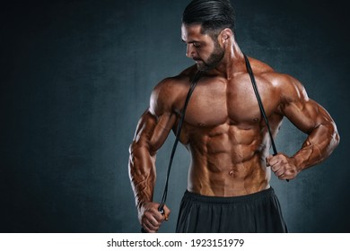 Handsome Muscular Men Exercise With Jump Rope, Skipping Rope
