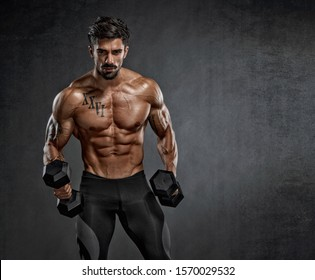 Handsome Muscular Men Lifting Weights