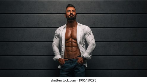 Handsome Muscular Men in White Shirt and Jeans