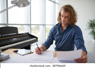 Handsome music composer working on new track