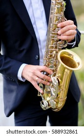 handsome musician is playing saxophone