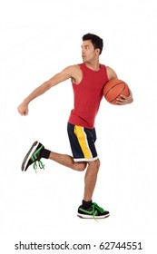 Handsome Nepalese man basketball player running with the ball and looking back. Studio shot. White background.