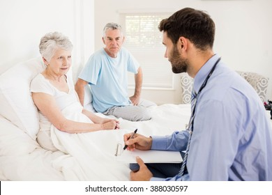 Handsome nurse visiting a mature woman at home