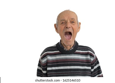 Handsome old man in casual clothes showes his mouth without teeth isolated over white background, need a dentist, copyspace, studio photo
