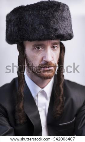 0ec0840a1ca Handsome Orthodox Jewish man Hasidim with a large fur hat and side locks in  a black