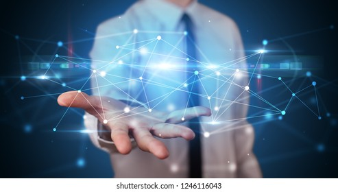 Handsome person holding hologram screen displaying modern cloud based web system technology