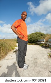Handsome personal trainer exercising in a popular park in South Beach in Miami.
