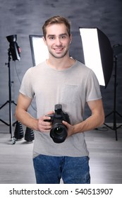 Handsome photographer with camera