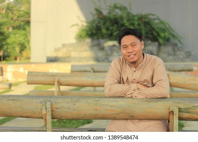 handsome portrait man with smile and stylish hand varies, the concept of relaxing is happy