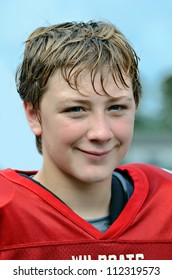 Handsome preteen boy during a football game.