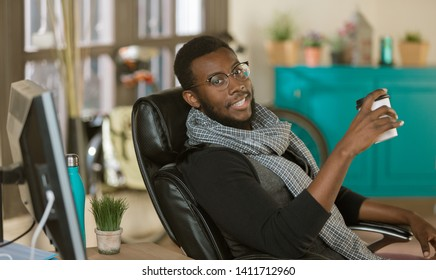 Handsome professional man in a creative office with coffee