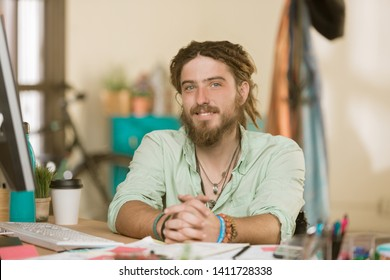 Handsome professional young man in a creative office