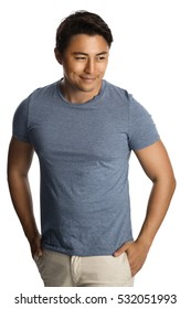 Handsome relaxed man wearing a tshirt and pants standing against a white background, relaxed looking.