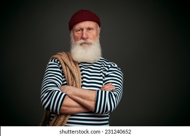 Handsome sailor isolated on black background. Seaman.