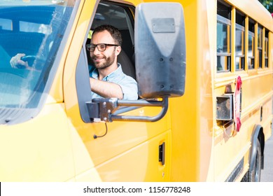 handsome school bus driver smiling and driving