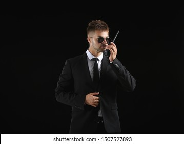 Handsome security guard on dark background