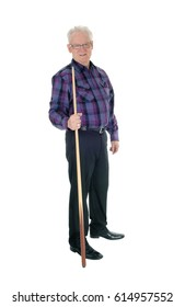 A handsome senior citizen man in a checkered shirt and jeans standingwith a billiard cue isolated for white background.