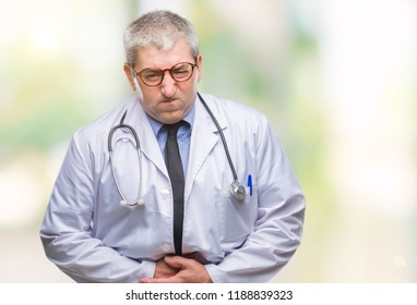 Handsome senior doctor man over isolated background with hand on stomach because nausea, painful disease feeling unwell. Ache concept.